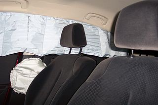 Deployed curtain and torso airbags